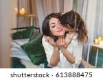 mom and daughter are hugging in ... | Shutterstock . vector #613888475