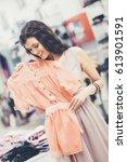 smiling caucasian woman buying... | Shutterstock . vector #613901591