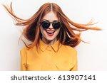 joyful woman with flying hair... | Shutterstock . vector #613907141