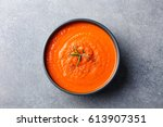 tomato soup in a black bowl on... | Shutterstock . vector #613907351