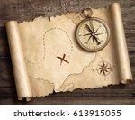 old brass nautical compass on... | Shutterstock . vector #613915055