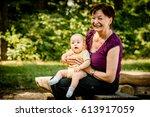 grandmother with grandchild  ... | Shutterstock . vector #613917059