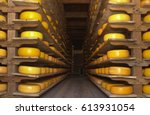 Cheese Stacked On Shelves In ...