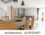 dining room with communal table ... | Shutterstock . vector #613932497