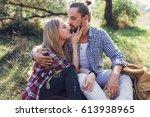 portrait of happy young couple...   Shutterstock . vector #613938965