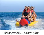 people ride on banana boat.... | Shutterstock . vector #613947584