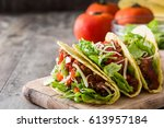 traditional mexican tacos with... | Shutterstock . vector #613957184