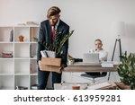 young upset fired businessman... | Shutterstock . vector #613959281