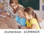 teacher with students using... | Shutterstock . vector #613984025