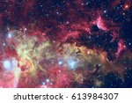 stars and galaxy in a deep... | Shutterstock . vector #613984307