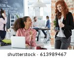 young women working in creative ... | Shutterstock . vector #613989467