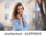 outdoors portrait of beautiful... | Shutterstock . vector #613990049