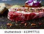closeup of a raw strip steak...