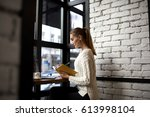 businesswoman watching online...   Shutterstock . vector #613998104