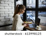 skilled young woman watching... | Shutterstock . vector #613998125
