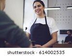 portrait of charming waitress... | Shutterstock . vector #614002535