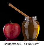 Honey And Red Apple On Black...