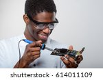 smiling man in safety glasses... | Shutterstock . vector #614011109