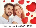 young beautiful couple on light ... | Shutterstock . vector #614019791