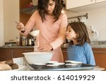 mother and daughter in the... | Shutterstock . vector #614019929