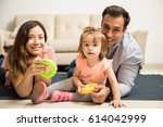 gorgeous family playing games... | Shutterstock . vector #614042999