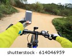 cyclist use smartphone for... | Shutterstock . vector #614046959