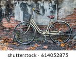 city bicycle on grey wall.... | Shutterstock . vector #614052875
