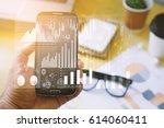 businessman using smartphone...   Shutterstock . vector #614060411