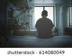 doctor sitting on the empty bed ... | Shutterstock . vector #614080049
