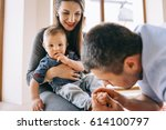happy family with son playing... | Shutterstock . vector #614100797