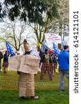 Small photo of Esther Short Park, Vancouver, Washington - April 2nd, 2017: Woman dressed as KKK protesting Donald Trump at a Pro-Trump rally