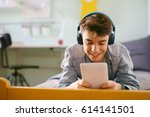 teenage boy using tablet in his ... | Shutterstock . vector #614141501