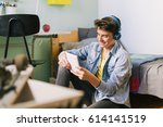 teenage boy using tablet in his ... | Shutterstock . vector #614141519