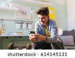 teenage boy texting message in... | Shutterstock . vector #614145131