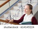 cute girl in school uniform... | Shutterstock . vector #614145224