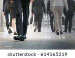 businessman legs walking go... | Shutterstock . vector #614165219