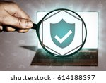 hand holds the magnifying glass ... | Shutterstock . vector #614188397