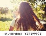 little girl enjoying sunshine... | Shutterstock . vector #614199971