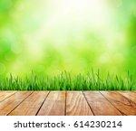 wooden table on bokeh light... | Shutterstock . vector #614230214
