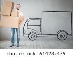man carrying boxes into new... | Shutterstock . vector #614235479