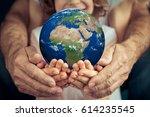 go green  family holding 3d... | Shutterstock . vector #614235545