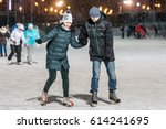 man and woman holding hands on... | Shutterstock . vector #614241695