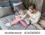 happy adorable daughter and... | Shutterstock . vector #614260001