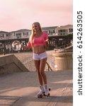 beautiful blond girl on roller... | Shutterstock . vector #614263505