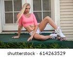 beautiful blond girl on roller... | Shutterstock . vector #614263529