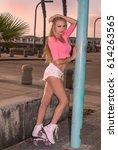 beautiful blond girl on roller... | Shutterstock . vector #614263565