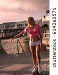 beautiful blond girl on roller... | Shutterstock . vector #614263571