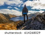 young girl standing on a view... | Shutterstock . vector #614268029