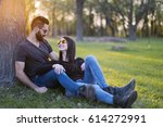 Couple At Spring Park In Sunset