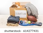 cardboard box with donation... | Shutterstock . vector #614277431